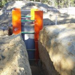 access chamber / manhole box in use around vertical pipe