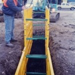 LITE guard standard shield lowered into trench by mini excavator