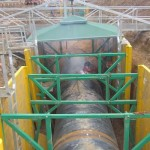 High clearance speader bars allowing trench shoring around a large diameter pipe.